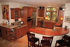 Cherry kitchen cabinets with radius elevated bar