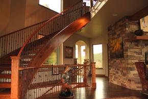 Curved  open tread stairway with metal ballusters