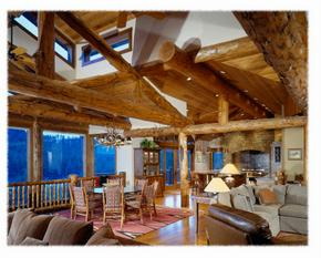 Mountain style home with log truss living room